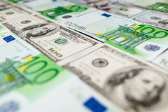 Euro banknotes close up. Several hundred euro banknotes. Euro vs dollar as background stock photography