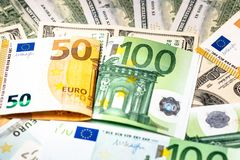Euro banknotes close up. Several hundred. Euro vs dollar as background stock photos