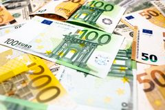Euro banknotes close up. Several hundred. Euro vs dollar as background stock photography