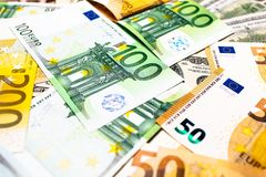 Euro banknotes close up. Several hundred. Euro vs dollar as background stock image