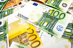Euro banknotes close up. Several hundred. Euro vs dollar as background royalty free stock photography