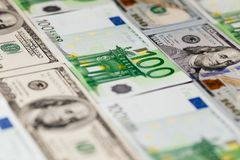 Large surface covered with US and European cash notes. stock photography