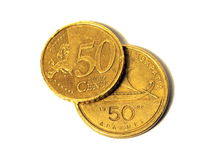 Grexit from the Eurozone. 50 cent euro coin on top of a Greek 50 drachma coin Stock Photography