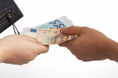 Euro and wallet. Handing out some euro bills while holding a wallet royalty free stock photography