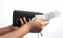 Euro and wallet. A hand holding a wallet and some euro bills stock image