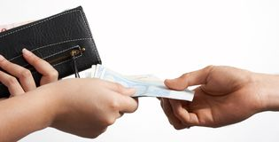Euro and wallet. Handing out some euro bills while holding a wallet royalty free stock photo