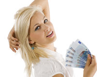 Euro woman. Cheerful young blond lady holding euro cash and smiling Royalty Free Stock Photos