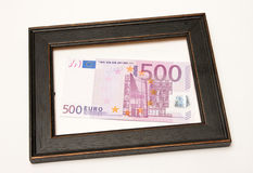 Euro in wood frame Stock Images
