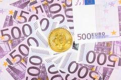 Euro y Bitcoin imagenes de archivo