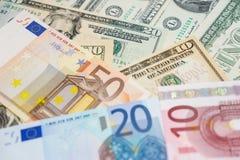 Euro y dólares Fotos de archivo