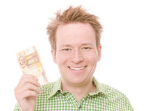 50 euro. Young happy smiling man holding a 50 euro banknote - isolated on white and retouched Royalty Free Stock Photography