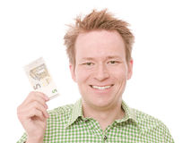 5 euro. Young happy smiling man holding a five euro banknote - isolated on white and retouched Royalty Free Stock Images