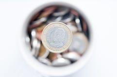 Euro zerrissen zur Hälfte gegen alten Hintergrund Stockbilder