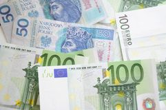 Euro and zloty bills Royalty Free Stock Images