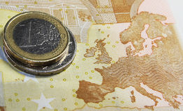 Euro zone. Euro coins and map of euro zone on the back of fifty euro banknote Stock Image