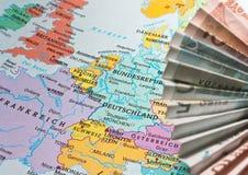 Euro zone  crises. Umbrella made  of euro bills  cover the western europe Stock Photos