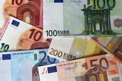 Euroanmärkningar som bildar bakgrund Fotografering för Bildbyråer