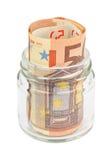 Eurobanknoten in einem Glas Stockbilder