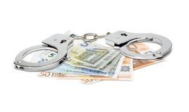 Eurobanknoten und Handschellen Stockfotografie