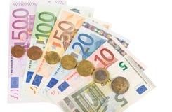 Eurobanknoten und Münzen Stockfotos