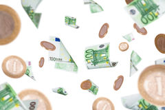 Eurobanknoten und Münzen-Fliegen Stockbilder