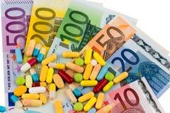 Eurobanknoten und Tabletten Stockbilder