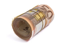50 Eurobanknoten zusammen gerollt und eingewickelt Stockbild