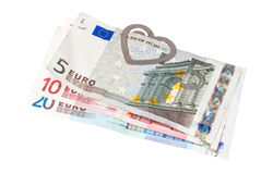 Eurobanknotes με έναν συνδετήρα εγγράφου υπό μορφή καρδιάς Στοκ Εικόνες