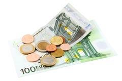 Eurobils mit Münzen Stockbilder