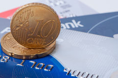 Eurocents on credit cards. Stock Photos