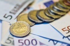 Eurocents und Banknoten Stockbilder