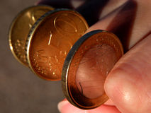 Eurocoins-power of money. Some eurocoins between a woman fingers Royalty Free Stock Photo