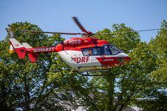 Eurocopter BK-117 from DRF Luftrettung flies over landing side. DELMENHORST / GERMANY - MAY 06, 2018: Eurocopter BK-117 from DRF Luftrettung flies over landing stock photos