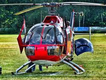 Eurocopter MBB Bo-105 of The Flying Bulls on grass airfield. Eurocopter MBB Bo-105 of The Flying Bulls on grass airfield in Goraszka. D-HTDM. Cabin door and stock photos