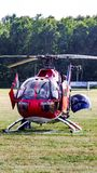 Eurocopter MBB Bo-105 of The Flying Bulls on grass airfield. Eurocopter MBB Bo-105 of The Flying Bulls on grass airfield in Goraszka. D-HTDM. Cabin door and Stock Photo