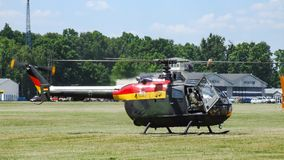 Eurocopter MBB Bo-105 of German Air Force on grass airfield. stock images