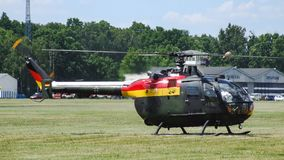 Eurocopter MBB Bo-105 of German Air Force on grass airfield. royalty free stock images