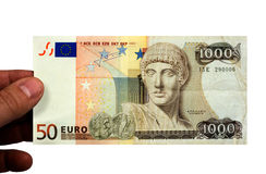 Eurodrachme. A 50 euro bill, and a 1000 drachmen bill combined Royalty Free Stock Images