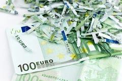 euroen strimlade unworthy Arkivfoto