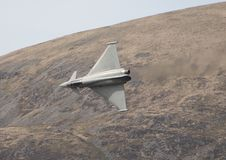 Eurofighter Typhoon. A Eurofighter speeds through a welsh valley stock photo