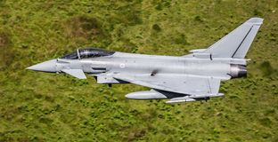 Eurofighter Typhoon jet. Aircraft at 600 mph through a valley in the U.K stock photo