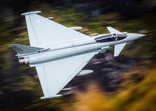 Eurofighter Typhoon jet. RAF Eurofighter Typhoon jet low level flying at high speed Royalty Free Stock Photo