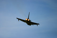 Eurofighter Typhoon at RAF Fairford air tattoo. Show in flight. delta wing jet fast action loud war sonic supersonic afterburner flight. fly military pilot Royalty Free Stock Photos