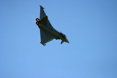 Eurofighter Typhoon at RAF Fairford air tattoo. Show in flight delta wing jet fast action loud war sonic supersonic afterburner flight fly military pilot force Royalty Free Stock Images