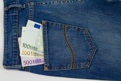 Eurogeld in Blue Jeans Lizenzfreie Stockfotos