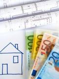 Eurogeld und Pläne Stockfotografie