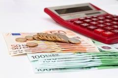 Eurogeld und Taschenrechner Lizenzfreie Stockbilder