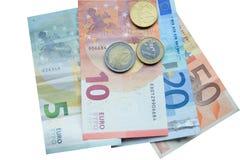 Eurogeldbanknote und -münzen Stockbild