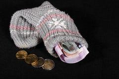 Eurogeldmenge in einer Socke Stockfotografie
