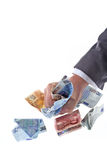 Eurograbber 02. Two hands grab some euro cash notes Stock Photo